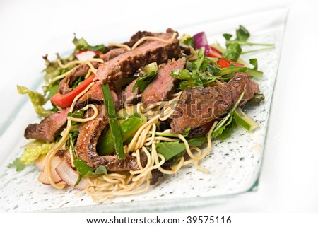 Thai beef salad with peppers and noodles