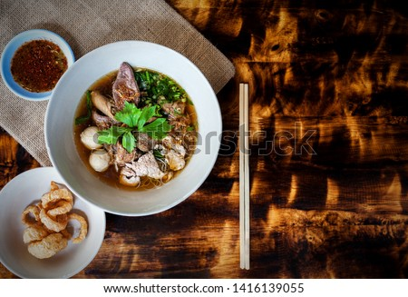 THAI BOAT NOODLE SOUP or KUAYTIAW REUA This delicious Thai noodle soup Local food in Thailand that can be eaten in general is delicious and cheap, Braised pork noodles,Thai food with copy space