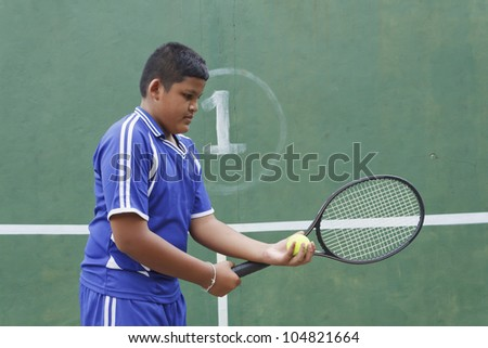 Thai boy tennis player learning how to preparing to play tennis