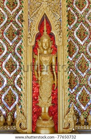 Thai Buddhist art in the stucco.