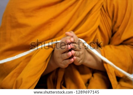 Thai buddhist monks Praying in Temple at Buddhist temple holding sacred cord or holy thread press the hands for worship in buddhism Religious ceremony - Image  Bangkok. Thailand, Southeast Asia.