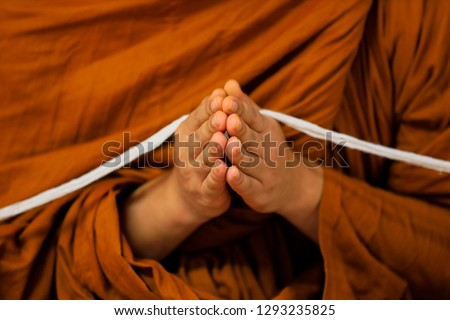 Thai buddhist monks Praying in Temple at Buddhist temple holding sacred cord or holy thread press the hands for worship in buddhism Religious ceremony - Image  Bangkok. Thailand, Southeast Asia. #1293235825
