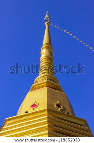 Thai Buddhist pagoda at Naka temple with blue sky background, Phuket province, Southern of Thailand