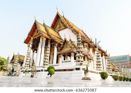 Thai Buddhist temple Bangkok Thailand ,Wat Suthat, better known for the towering red Giant Swing that stands at its entrance, is one of the oldest and most impressive buddhist temples in Bangkok,