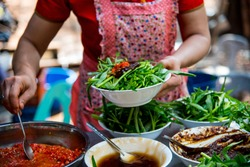 Thai chef prepare ingredient for stir fried chinese morning glory
