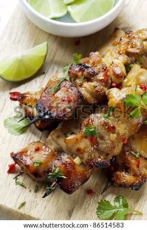 Thai chicken skewers marinated with chili, coriander or cilantro, and lime.