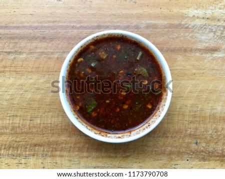 Thai chilli sauce on wood table #1173790708