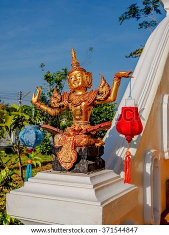 Thai classical dancer statue in a garden #371544847