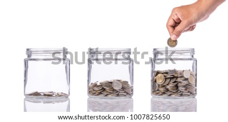 Thai coin (baht) in clear glass jar with different level from less to more. Studio shot isolated on white background. Save money or investment financial for future concept