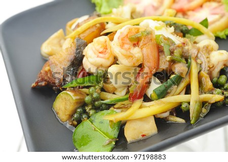 thai cuisine fried basil spicy seafood - shrimp-squid - fish and herb - phad khee mao talay