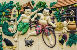 Thai culture stone carving on house wall