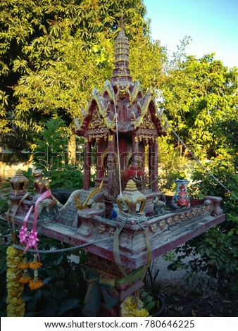 Thai definition or Spirit house.The spirit house can be seen at a prominent spot outside every business establishment in the country.The spirit house is built at the yard of every home. #780646225