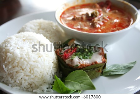 Thai dish of spicy curry steamed fish pudding and rice traditional cuisine