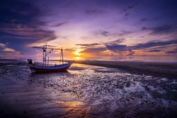 Thai Fishing boat at sunrise and low tide. Ao Noi, Khiri Kan District. Thailand.