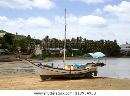 Thai fishing schooner on the coast at low tide