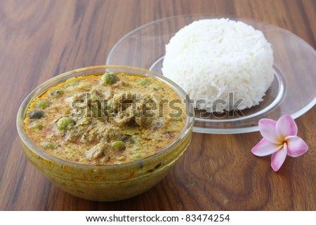 Thai food beef curry with rice in wood background