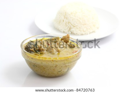 Thai food beef curry with rice isolated in white background