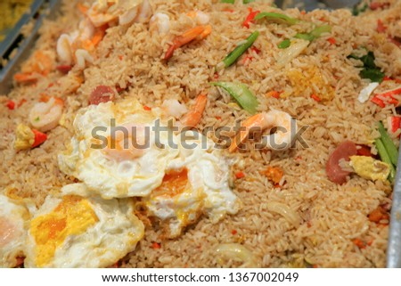 Thai food, fried rice with shrimps and eggs on a market in Thailand, Southeast Asia, Asia