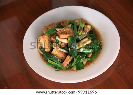 Thai food. fried tofu stir with garlic leafs, pepper, and sauce