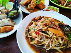 Thai Food, Northeastern Thai cuisine food, Thai Papaya Salad (Som Tam), grilled pork neck are most popular food in Thailand with spicy and delicious.