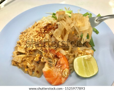 Thai food, Pad Thai menu. soft and sticky Thai noodles fried with egg and shrimp. Stir with bean sprouts, ground beans and spring onion, add chili powder for spicy and lemon for sour taste