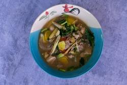 Thai food spicy chilli chicken feet soup Thailand call
