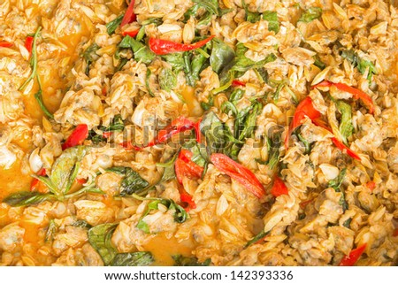 "Thai food : spicy stir fried clams with basil : in Thai language called "" Hoi Lai Pad Cha """