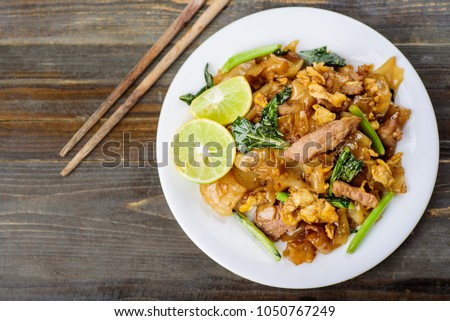 Thai food, stir fried rice noodle in soy sauce (Pad See Ew), top view