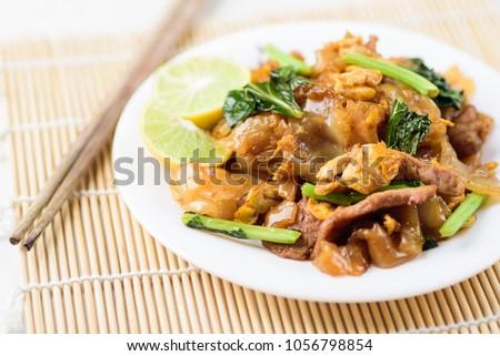Thai food, stir fried rice noodles in soy sauce (Pad See Ew)