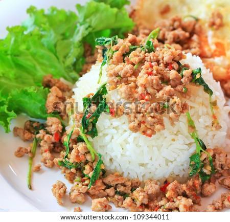 Thai food Thai spicy food, Fried pork with sweet basil.whit basi