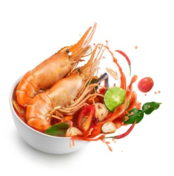 Thai food Tom Yum Gong.Thai hot and spicy soup shrimp in bowl.with Straw Mushroom,lime,Kaffir lime leaves,tomato and chilli. Splash on the air. isolated on white background.