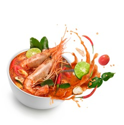 Thai food Tom Yum Kung.Thai hot and spicy soup shrimp in bowl.with Straw Mushroom,lime,Kaffir lime leaves,tomato and chilli. Splash on the air. isolated on white background.