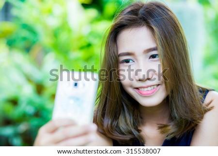 Thai girl play smartphone #315538007