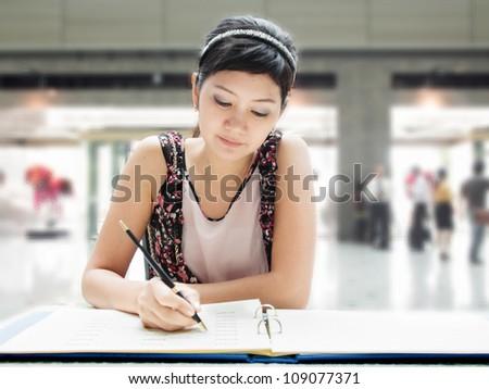 Thai girl writing
