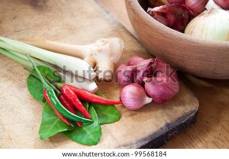 Thai herb ingredients for Tom Yum on wood