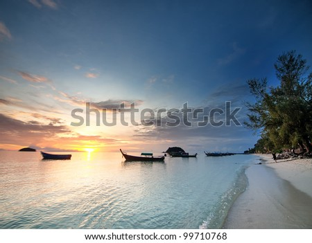 Thai longtail boat in the sea on sunrise