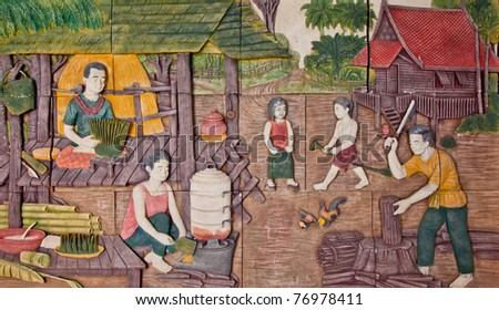 Thai low relief image illustrated former Thai people in rural life style