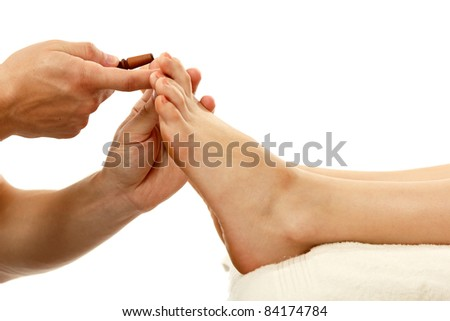 Thai massage foot female close-up isolated on white background