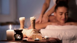 Thai massage. Woman receiving back massage, relaxing in spa and enjoying aroma therapy
