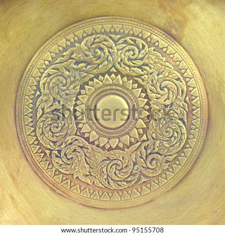 Thai pattern on old brass plate
