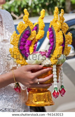 Thai people holding flower for wedding ceremony in Thailand