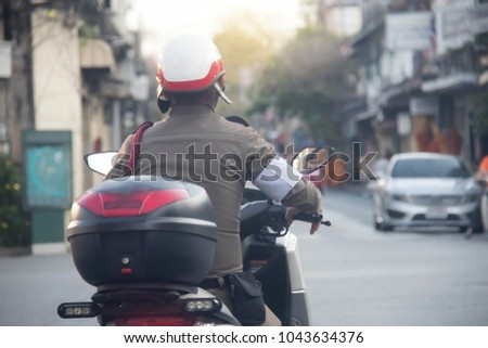 Thai police : Patrol : Police patrolled motorbike, morning reconnaissance in city location: soft Focus and blurry