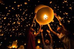 Thai's Family release sky lanterns to worship buddha's relics in yi peng festival, Chiangmai thailand