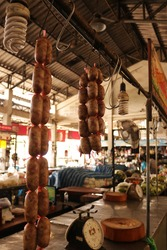 Thai sausages in a long bunch are hung for display to sell to customers for cooking