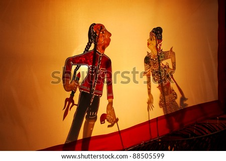 Thai Shadow puppet is folk show, it playing with shadow on shadow theatre screens? It public all anyone can do it. no copyright in it / Thai Shadow puppet is folk show