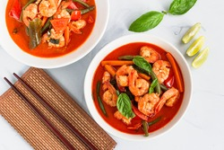 Thai Shrimp Red Curry Directly Above Photo. Traditional Thai Red Curry Soup with Prawn / Shrimp.