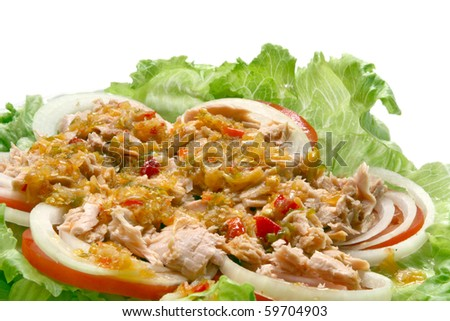 Thai spicy Tuna with Green salad onion and tomato, closeup