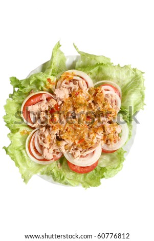 Thai spicy Tuna with Green salad onion and tomato isolated on white