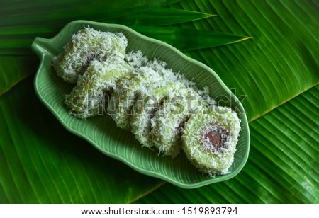 Thai Steamed  Sticky Rice with banana topping with fresh coconut (Thai name is Khao Tom Hor Hngok).Thai treditional desert. #1519893794