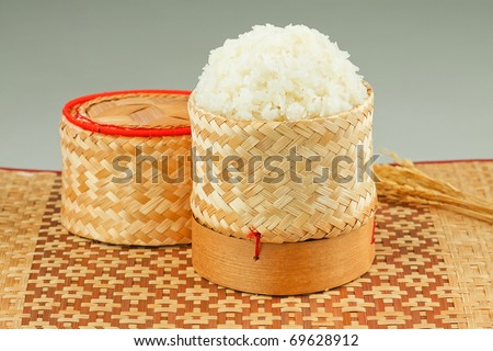 Thai sticky rice in a bamboo wooden old fashioned style box isolated